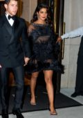 Priyanka Chopra wears a black sheer dress while arriving at Cipriani Wall Street with Nick Jonas in New York City