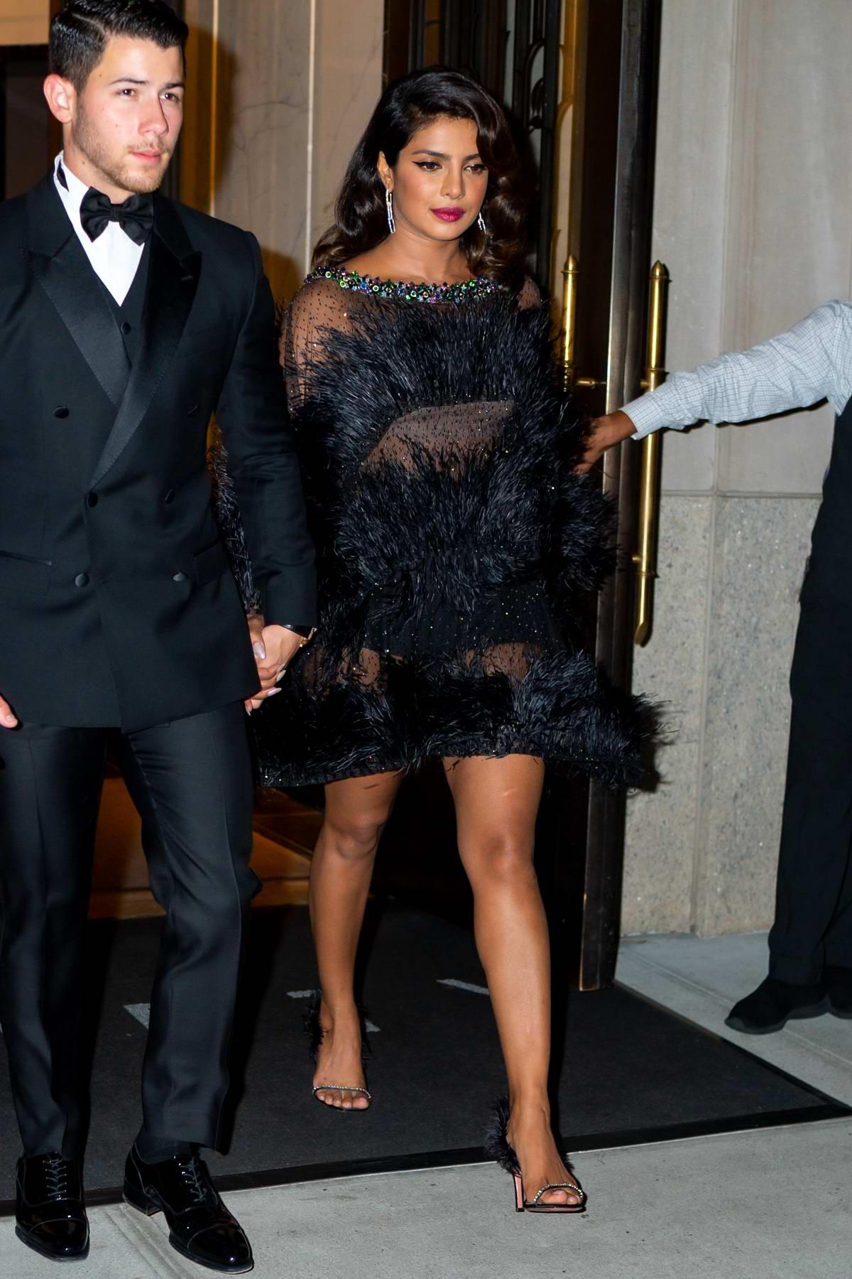 Priyanka Chopra wears a black sheer dress while arriving at Cipriani Wall Street with Nick Jonas in New York City