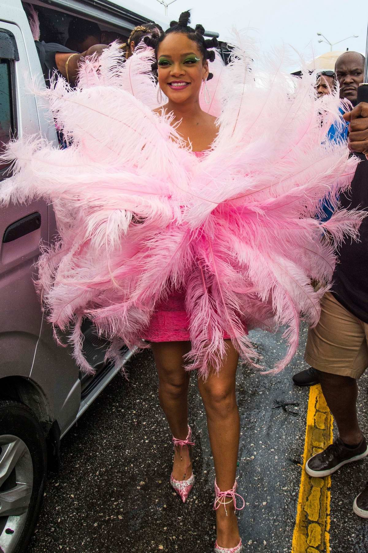 Rihanna dazzles in a pink feathered costume at annual Crop Over Festival in Barbados