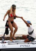 Rita Ora seen wearing a red and black bikini while enjoying a boat ride with friends in Ibiza, Spain