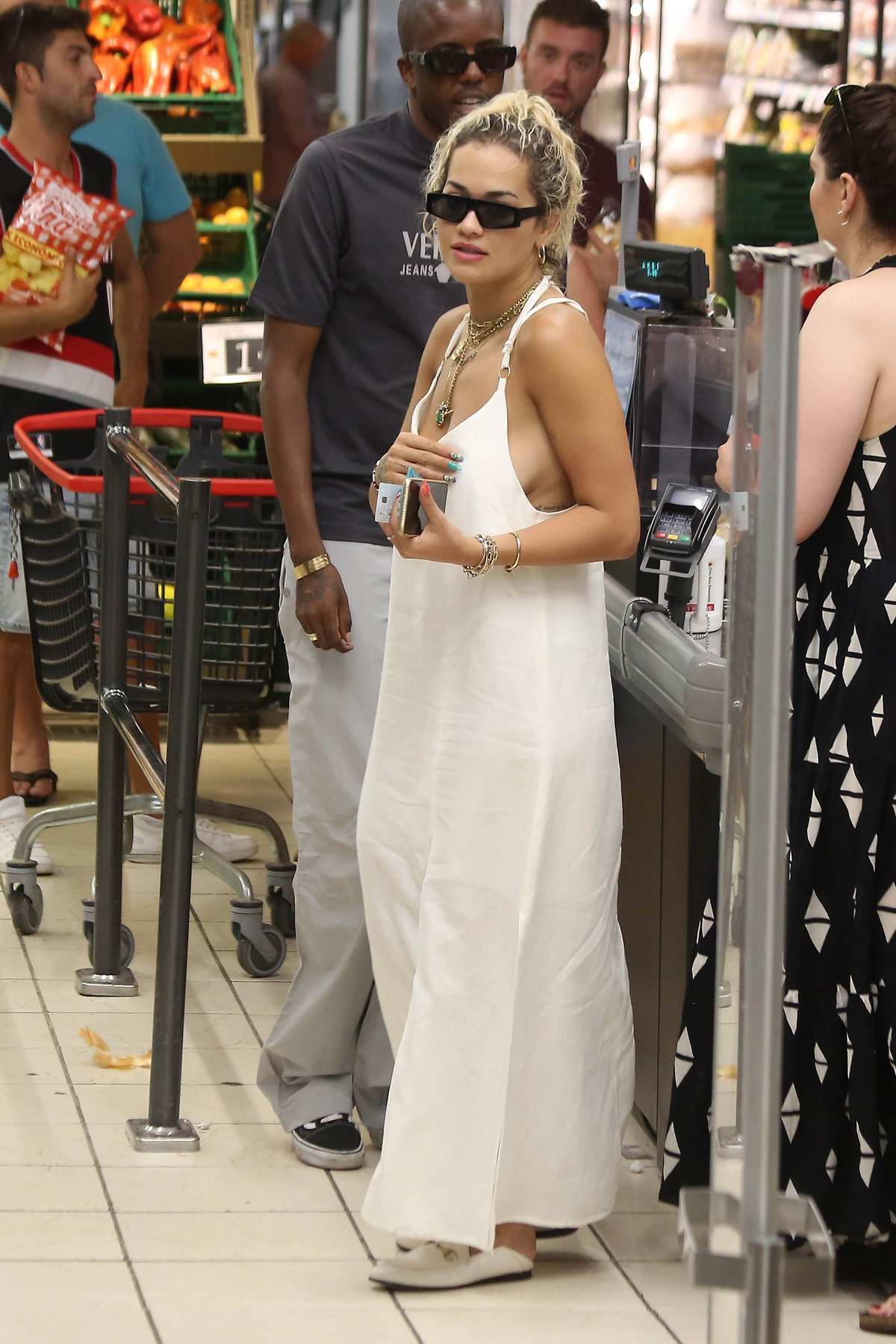 Rita Ora steps out in a white dress for some shopping during her vacation in Ibiza, Spain