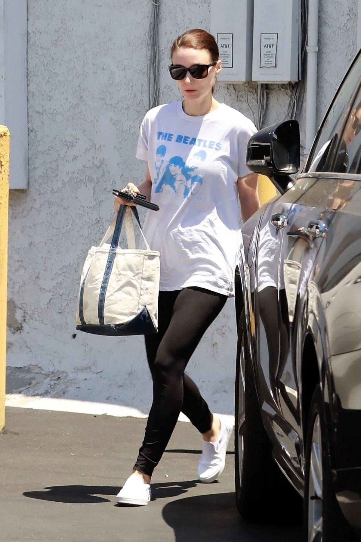 Rooney Mara keeps it simple with a white tee and black leggings while out running errands in Los Angeles