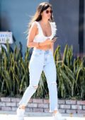 Sara Sampaio shows off her abs in a white crop top while out for a walk in Los Angeles