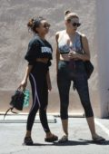 Sarah Hyland dons a cropped 'Dogpound' sweatshirt and leggings as she leaves the gym with a friend in Los Angeles