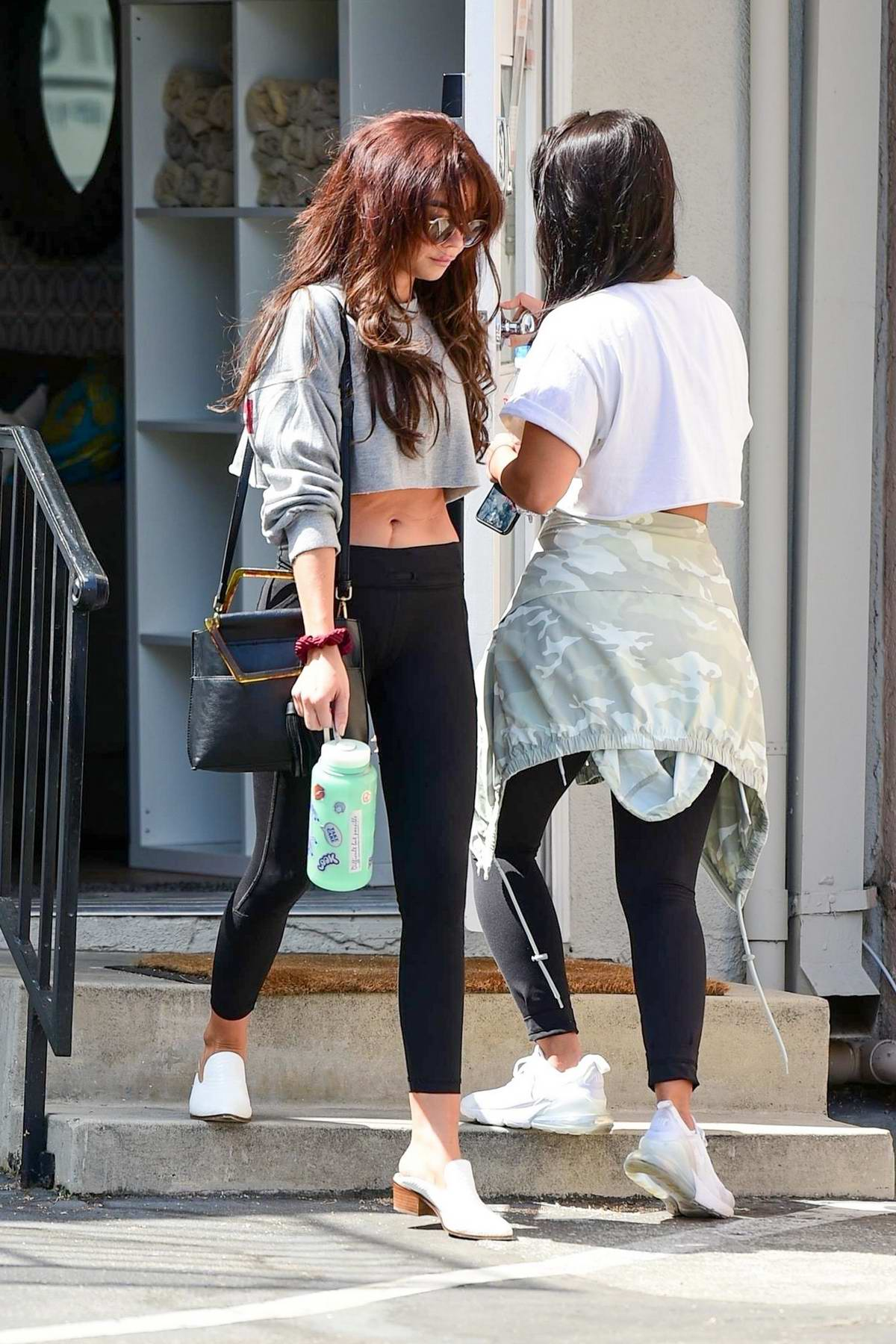 Sarah Hyland flashes her abs as she leaves the gym after her workout in Studio City, Los Angeles