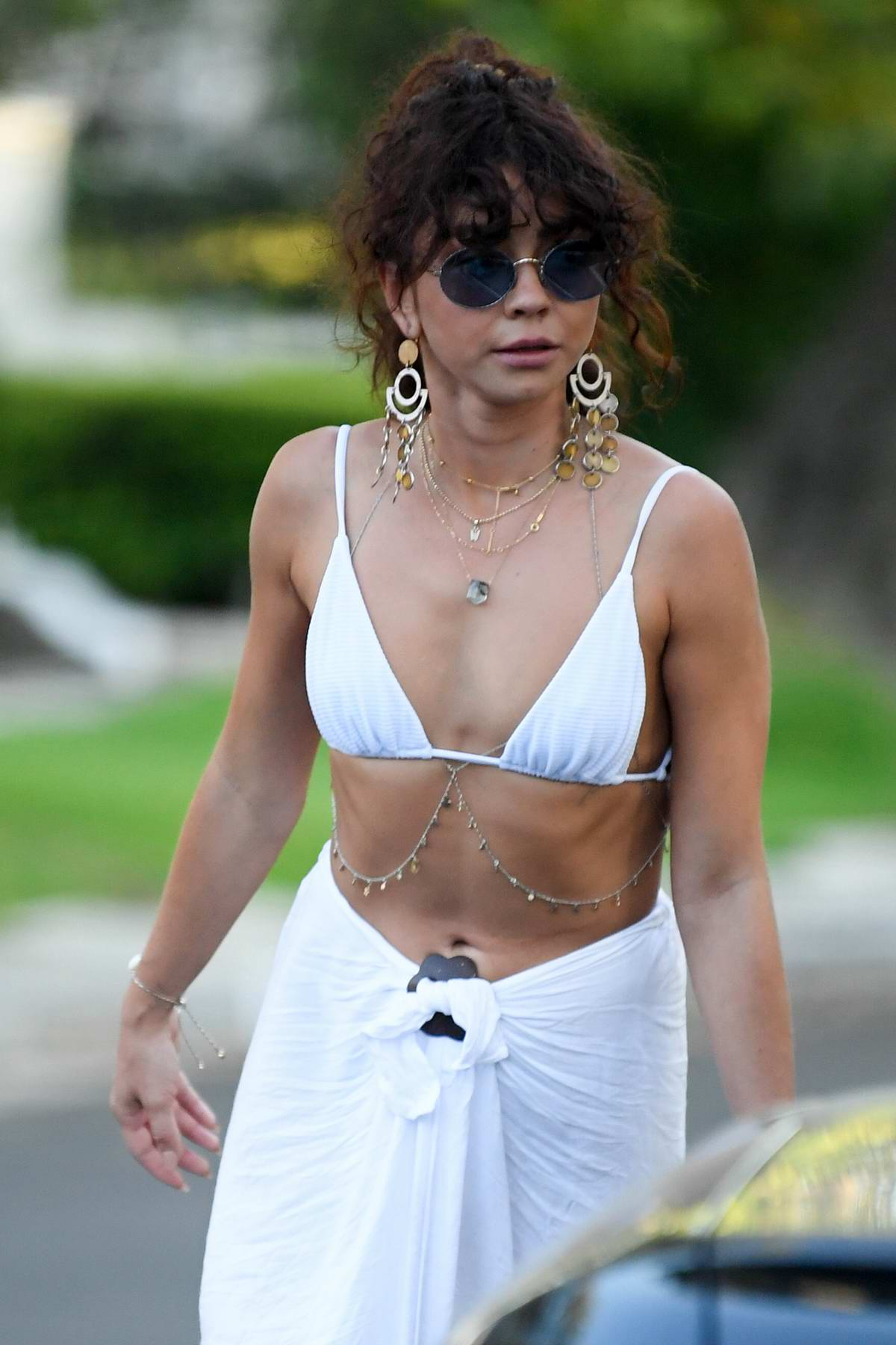 Sarah Hyland spotted in a white bikini top as she leaves a pool party in Los Angeles