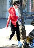 Selena Gomez looks great in a white top and black leggings as she leaves after a workout session in Los Angeles