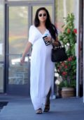 Shay Mitchell shows off her baby bump in a white dress as she heads to a Foot Spa in Hollywood, California