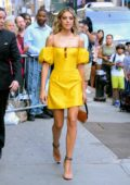 Sistine Stallone stands out in a bright yellow dress as she arrives at Good Morning America in New York City