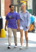 Sophie Turner and Joe Jonas hold hands as they go for a casual stroll through Manhattan in New York City