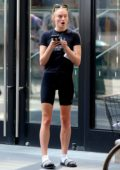 Sophie Turner sports a black Harley Davidson tee and black legging shorts while out for a stroll in SoHo, New York City