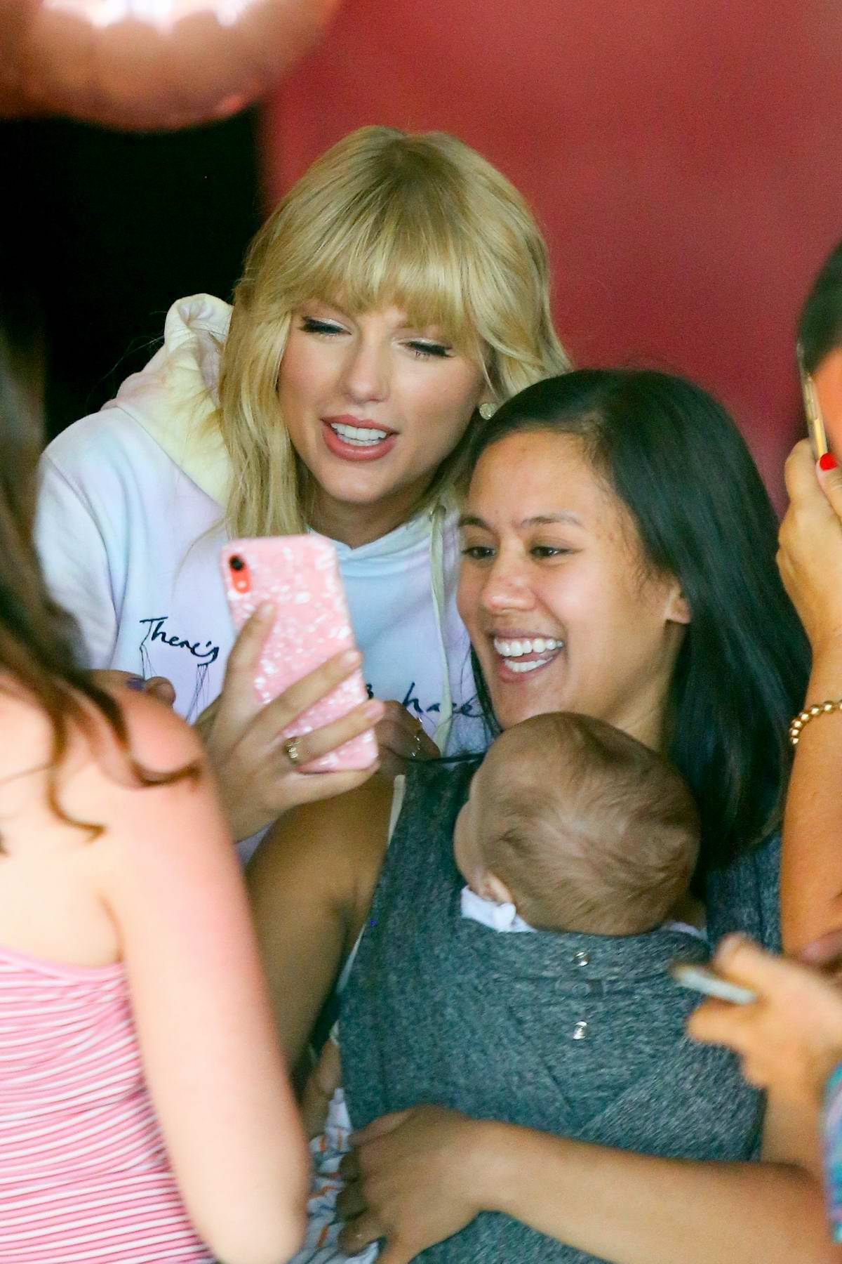 Taylor Swift greets with her fans at her 'The Lover Experience' pop up shop in Manhattan, New York City