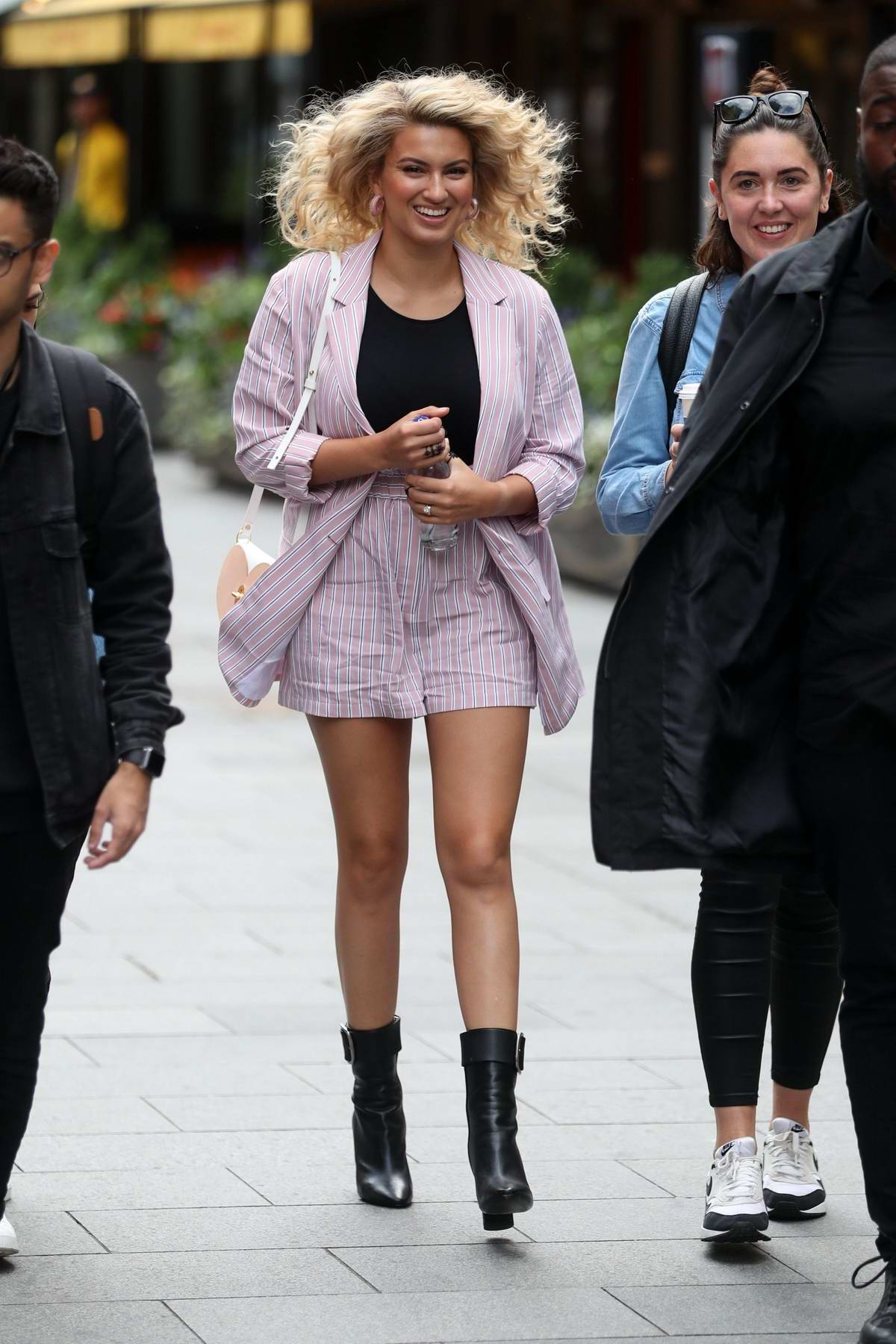 Tori Kelly looks great in a striped pink shorts suit as she arrives at Global Radio in London, UK