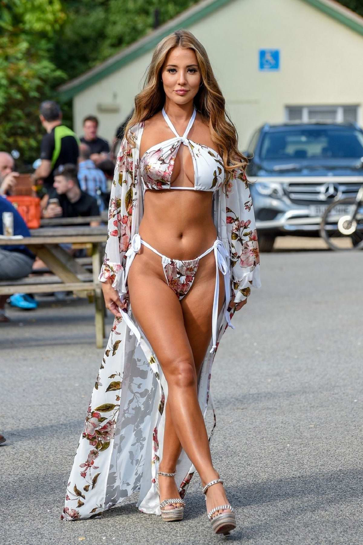 Yazmin Oukhellou seen wearing a floral print bikini at a pool party in Essex, UK