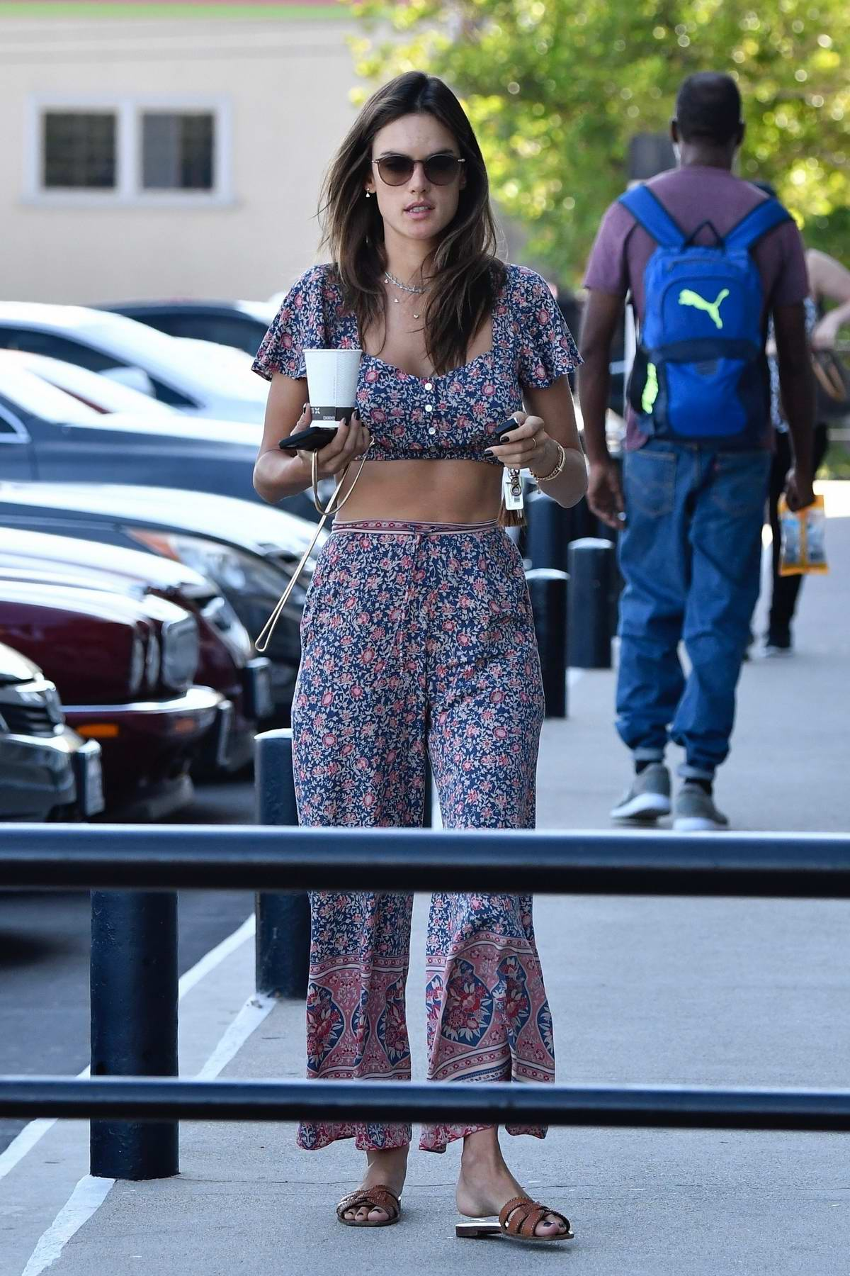 Alessandra Ambrosio looks great in a matching floral print outfit while running errands in Los Angeles