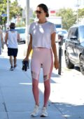 Alessandra Ambrosio wears a white t-shirt and pink leggings during a trip to a nail salon in Brentwood, Los Angeles