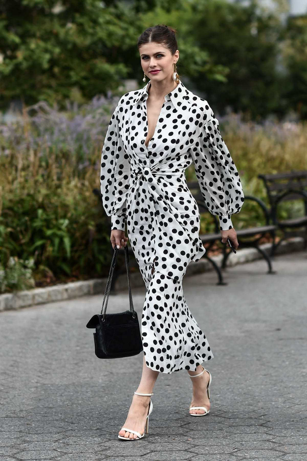 Alexandra Daddario looks gorgeous in a polka dot dress while attending Carolina Herrera Show during NYFW in New York City