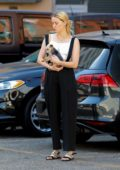 Amber Heard cradles her little pooch while out in Downtown's Fashion District in Los Angeles
