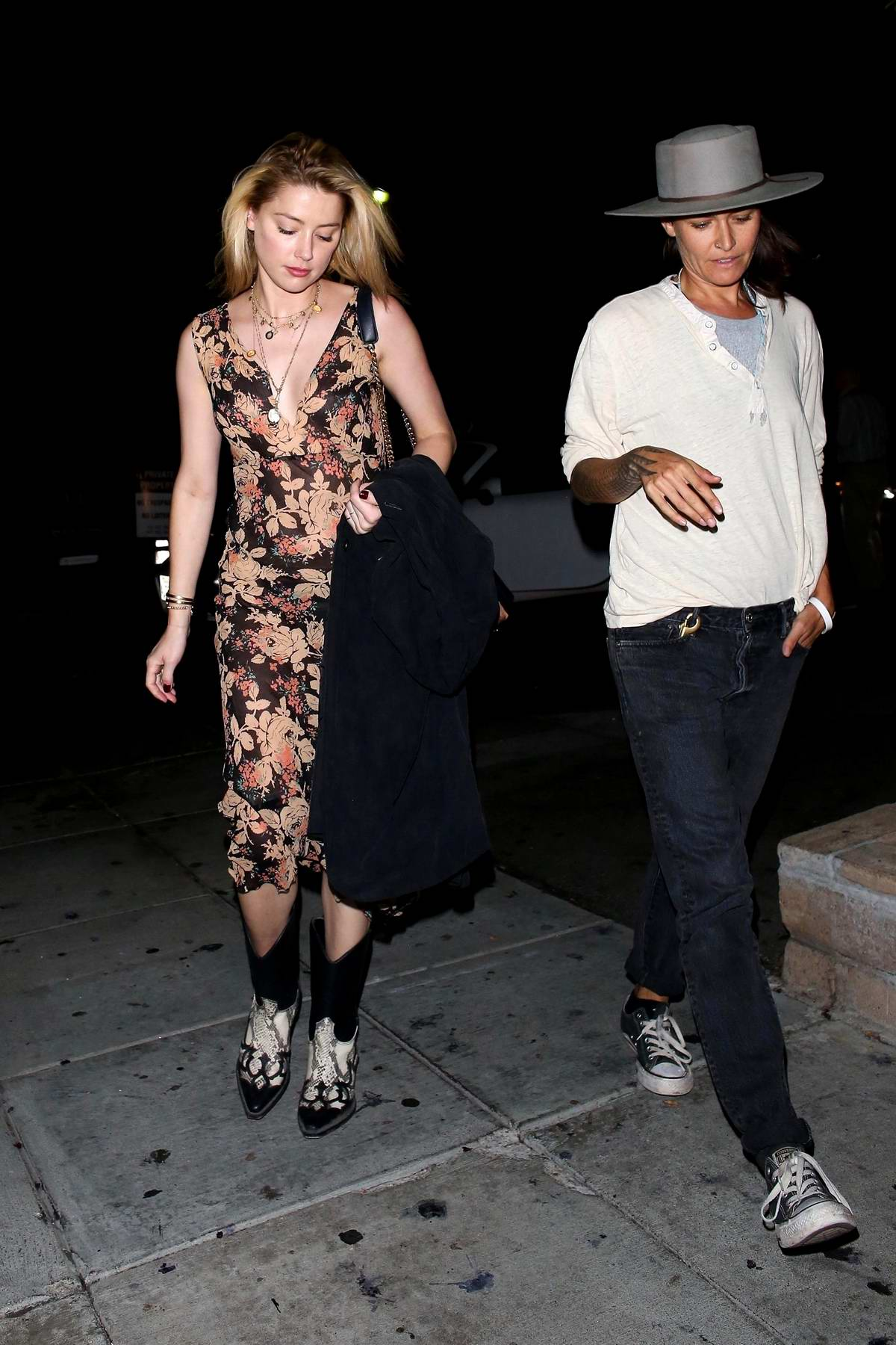 Amber Heard looks beautiful in a floral print dress as she grabs dinner with a friend in Beverly Hills, Los Angeles