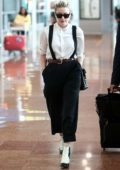 Amber Heard sports a chic look as she touches down at Charles de Gaulle Airport in Paris, France