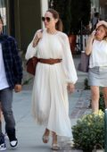 Angelina Jolie looks elegant in a white dress while out for lunch with her kids at Fig & Olive in Hollywood, Los Angeles