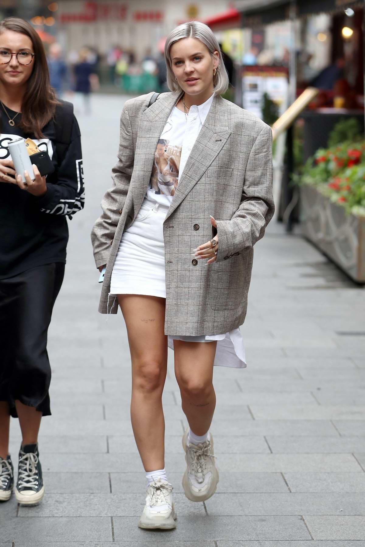 Anne-Marie is all smiles as she leaves Global Radio Studios in London, UK