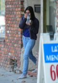 Ariel Winter covers her face with her shirt as she leaves an Actors Studio class in Studio City, Los Angeles