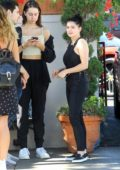 Ariel Winter spotted in black denim overalls during a lunch outing with friends in Beverly Hills, Los Angeles