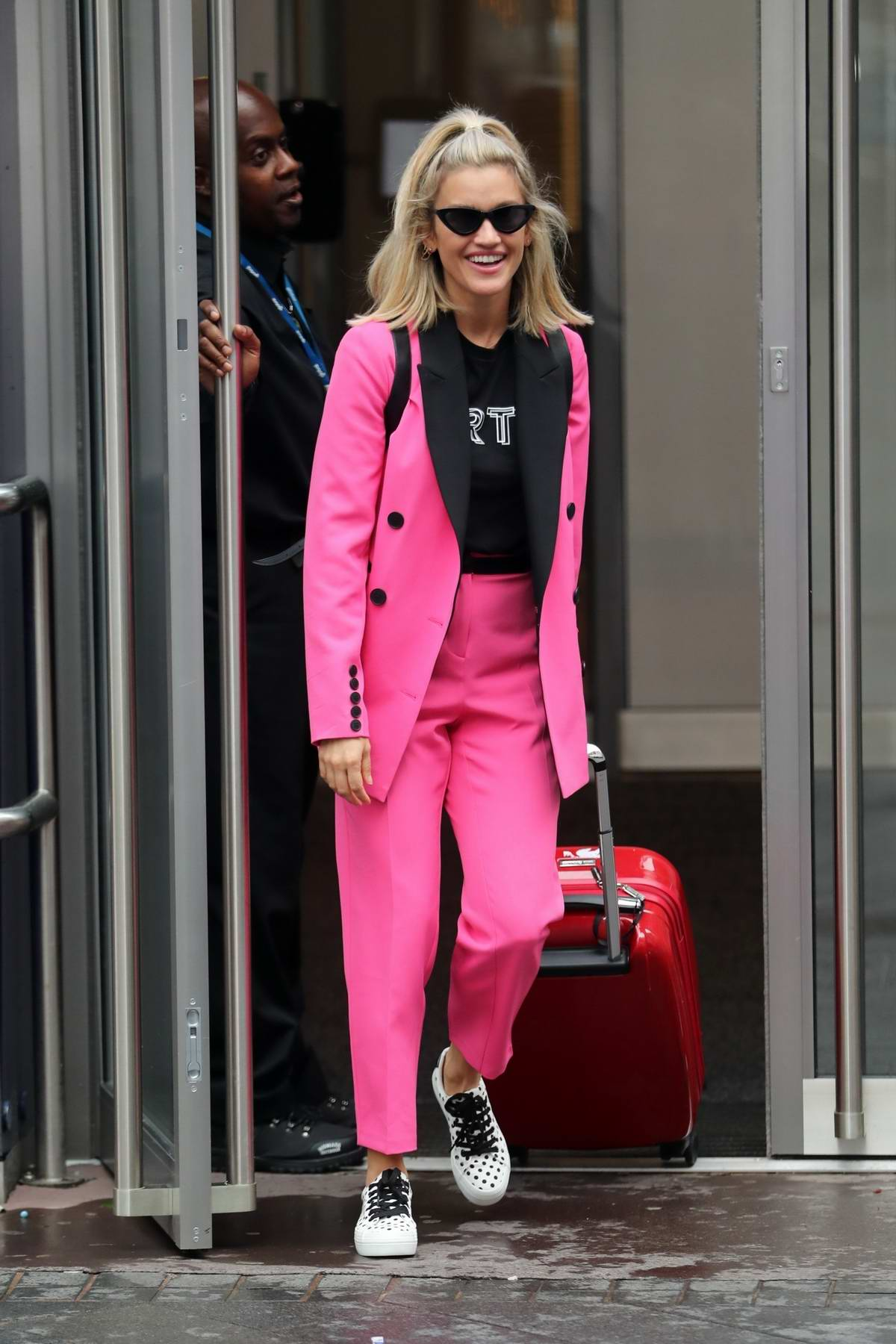 Ashley Roberts pops in bubble gum pink suit as she leaves Heart radio in London, UK