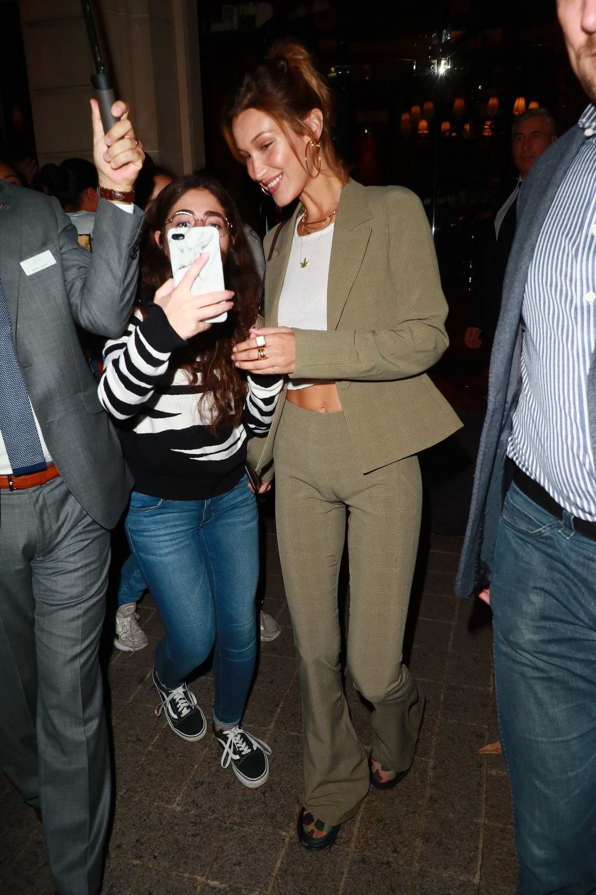 Bella Hadid greets fans as she leaves Royal Monceau hotel during PFW in Paris, France