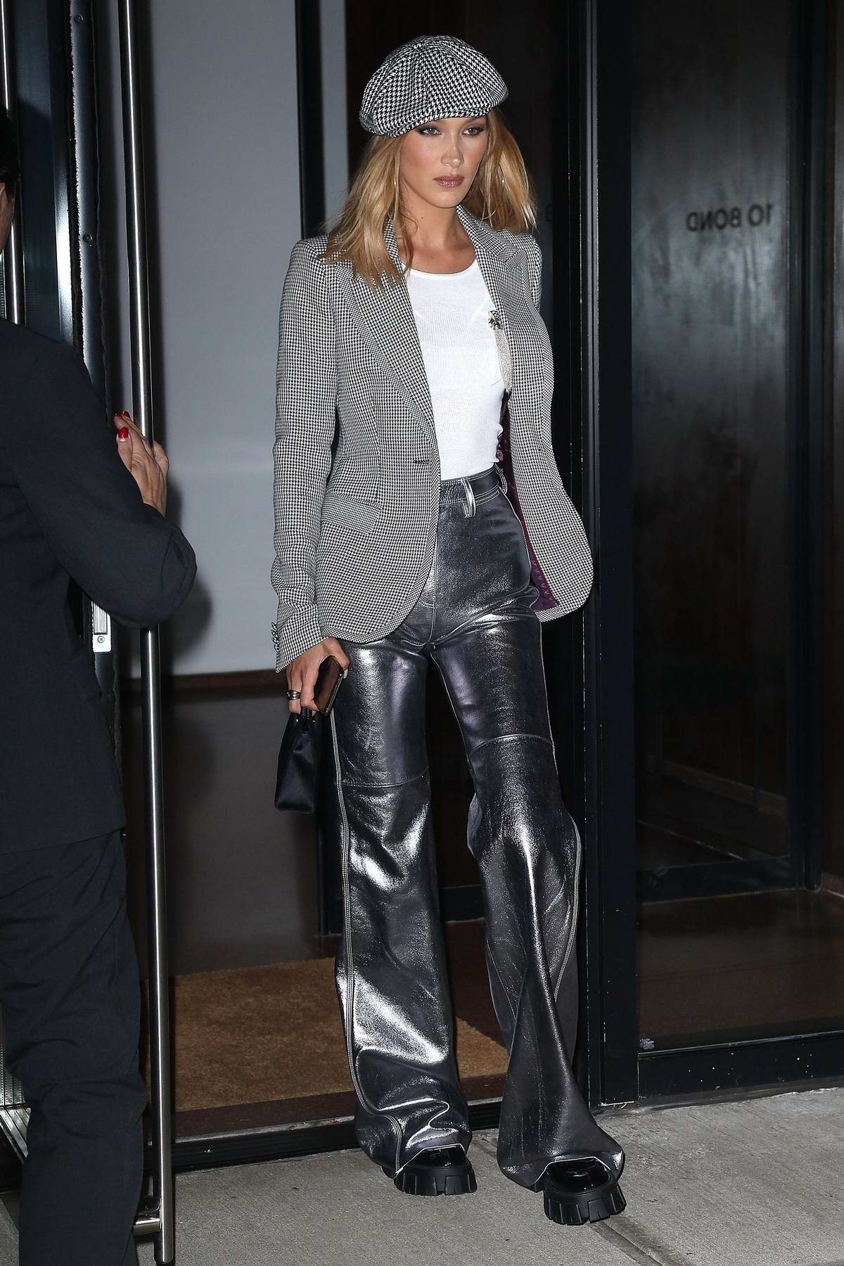Bella Hadid looks stylish in a tweed blazer paired with metallic silver pants as she heads for a night out in New York City