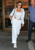 Bella Hadid rocks a corset-like top with her all-white ensemble during a NYFW fitting in New York City