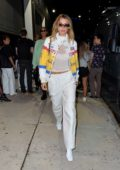 Bella Hadid rocks a racing jacket as she leaves the Brandon Maxwell show during New York Fashion Week in New York City