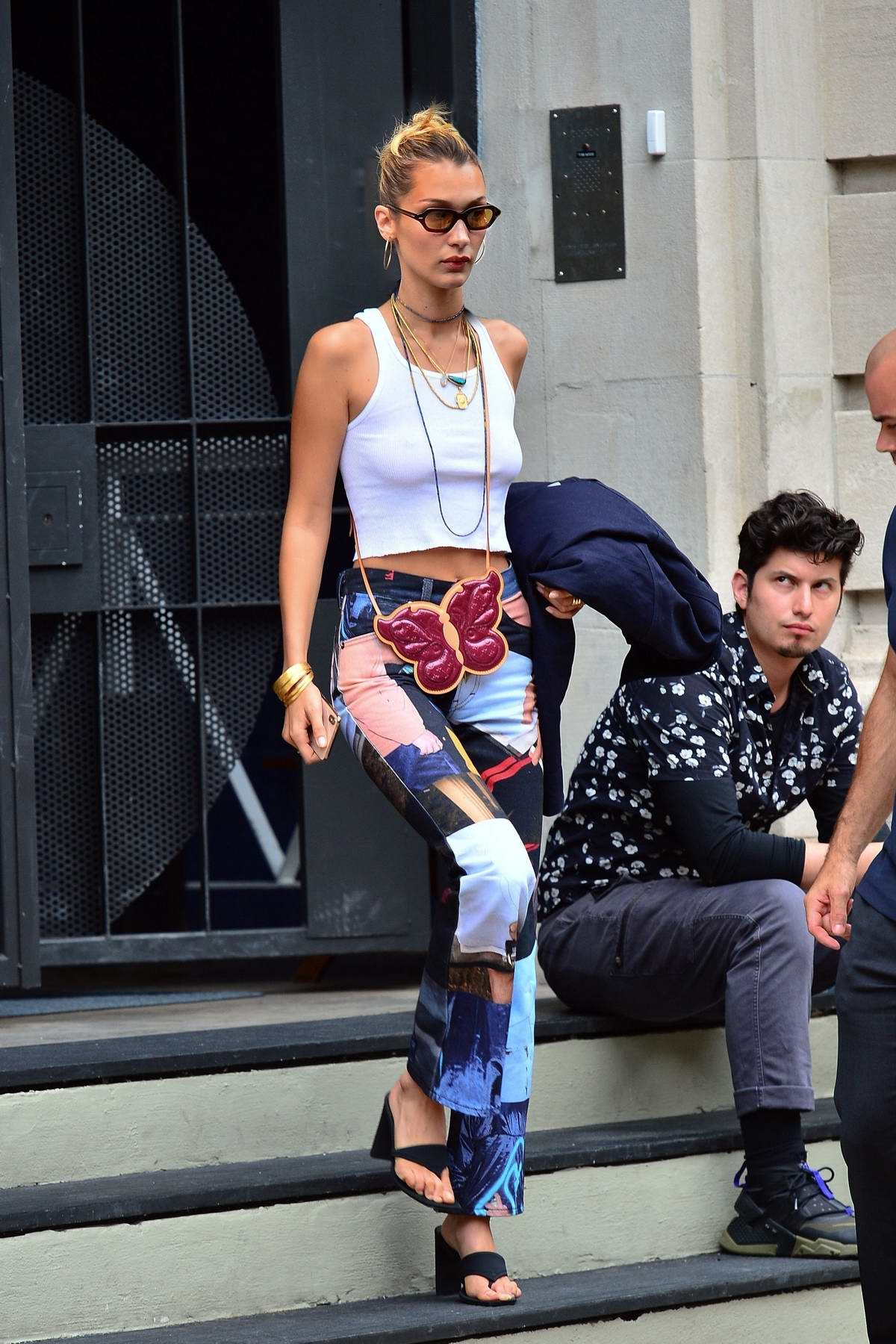 Bella Hadid rocks patchwork denim pants as she heads to NYFW fittings in New York City