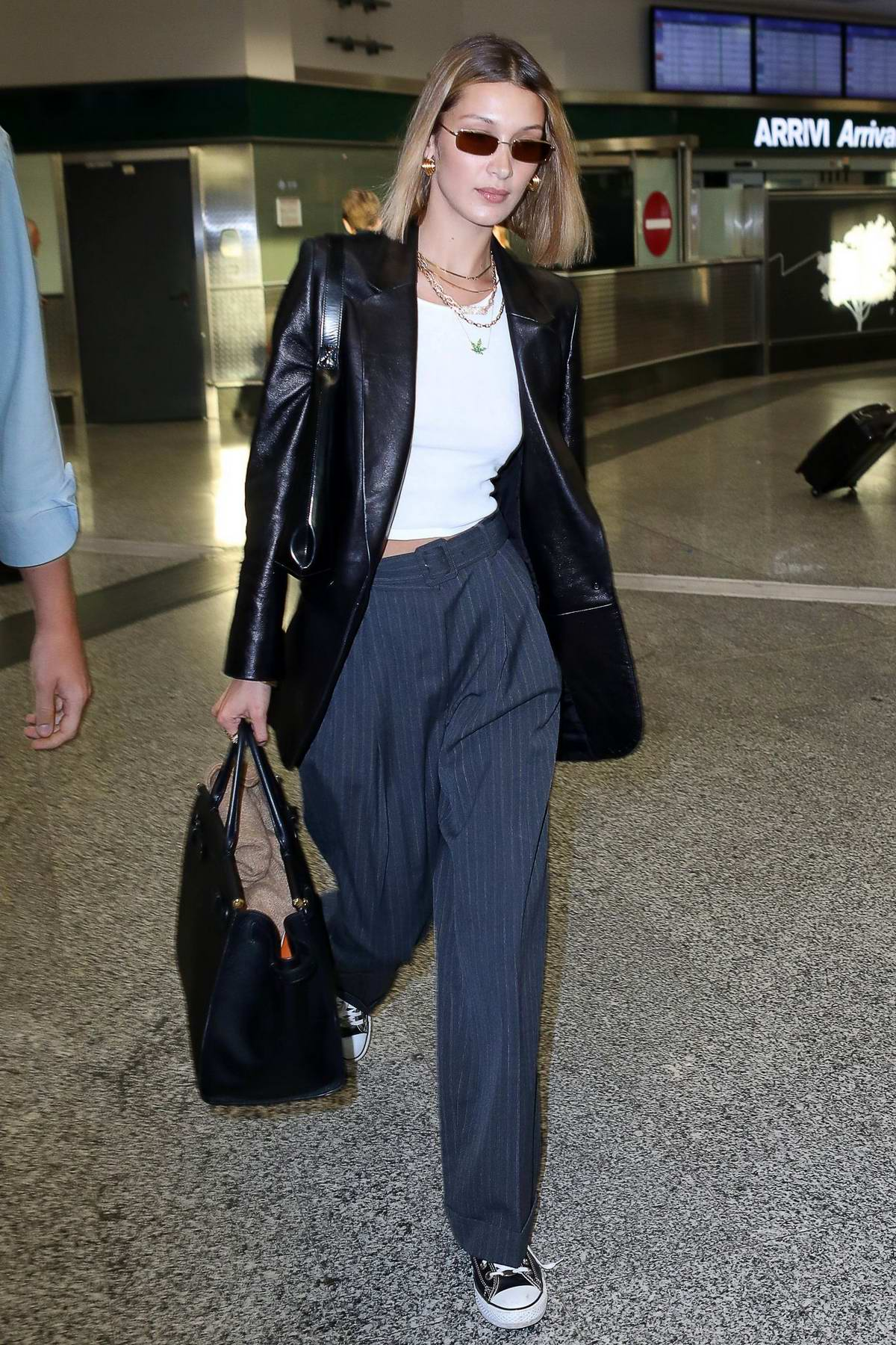 Bella Hadid touches down at Malpensa airport as she arrives for Milan Fashion Week S/S 2020 in Milan, Italy