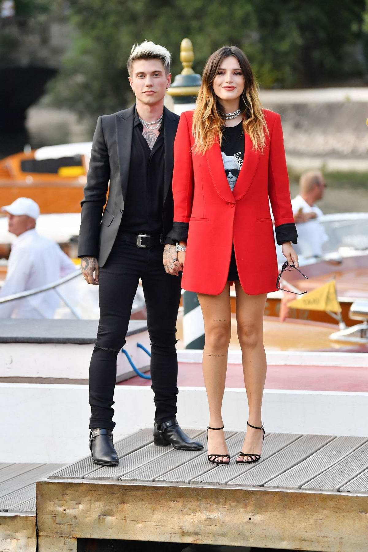Bella Thorne and Benjamin Mascolo pose for photos during the 76th Venice Film Festival in Venice, Italy