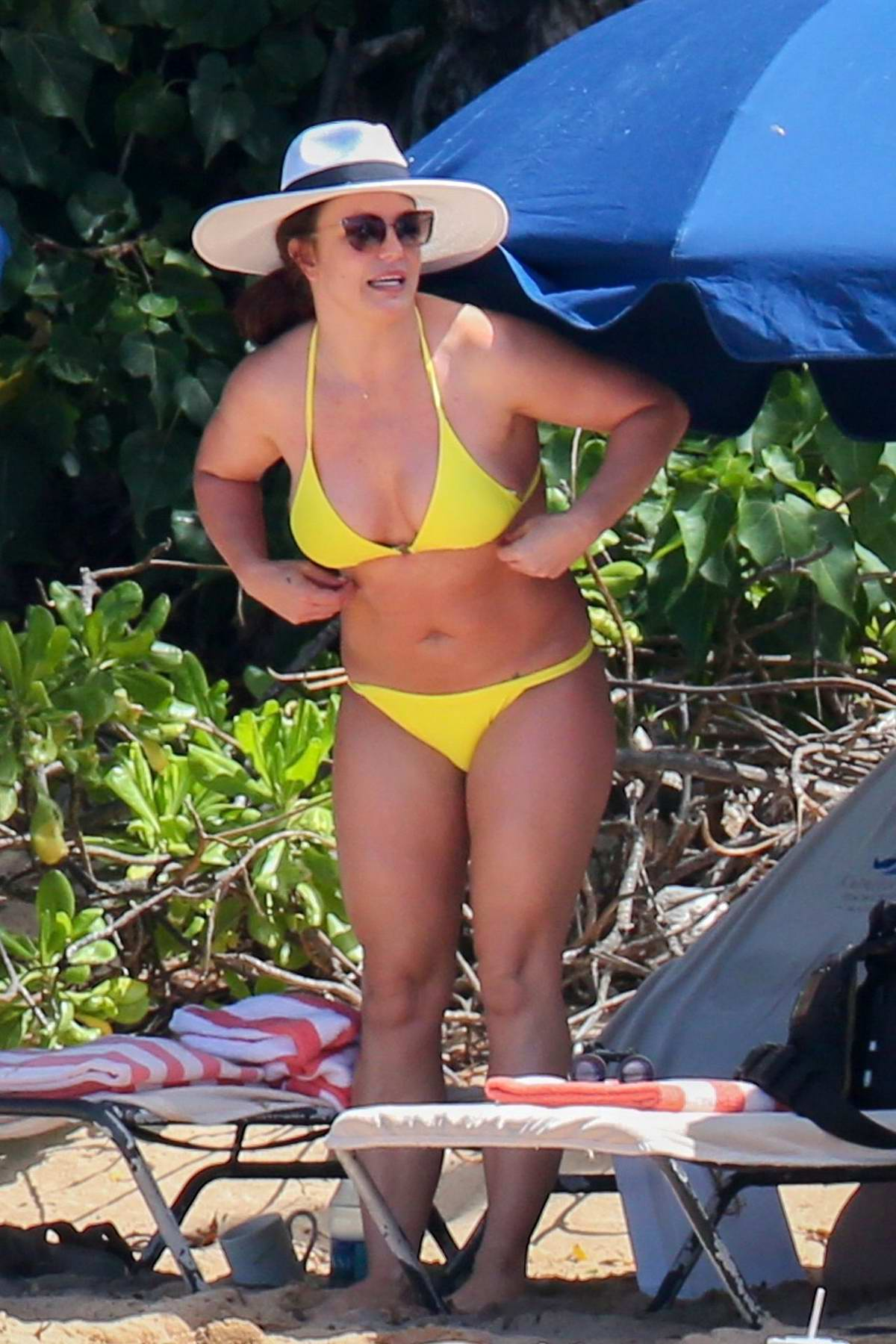 Britney Spears wears a yellow bikini as she hits the beach in Hawaii