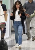 Camila Cabello checks her phone as she touches down at LaGuardia Airport in New York City