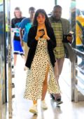 Camila Cabello looks cute in a polka dot slit dress as she arrives at JFK Airport in New York City