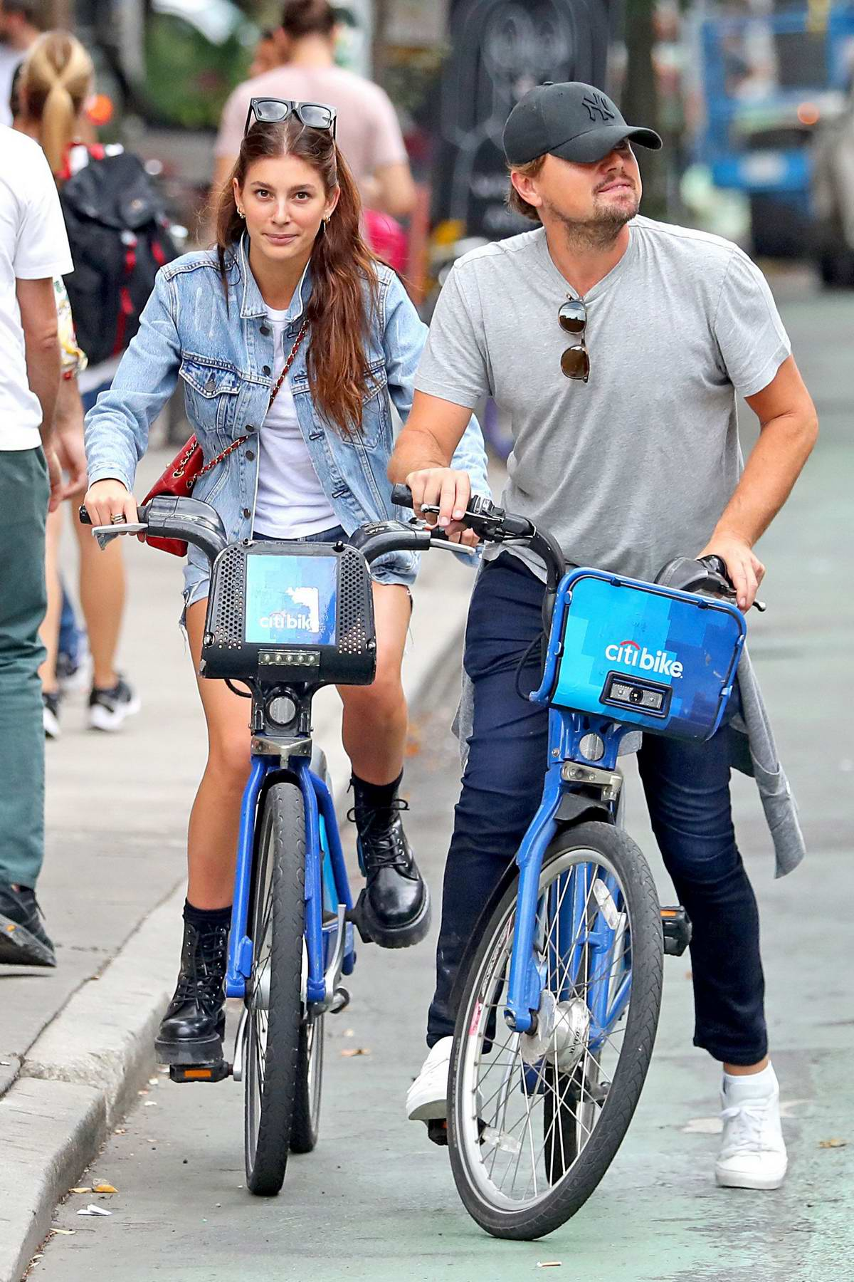 Camila Morrone and Leonardo DiCaprio go for a bike ride followed by a hand in hand stroll in New York City