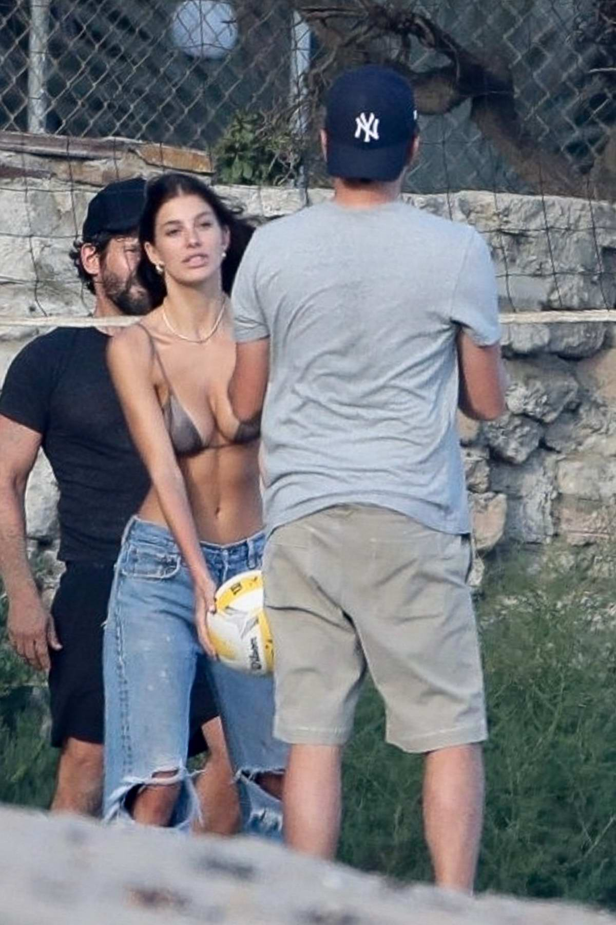 Camila Morrone and Leonardo DiCaprio seen playing beach volleyball with April Love Geary and Lukas Haas in Malibu, California