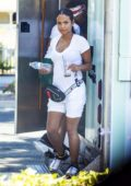 Christina Milian dons a white top and shorts while working at her Beignet Box mobile unit in Studio City, Los Angeles