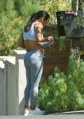 Christina Milian spotted checking the mail box wearing sports bra and leggings, Los Angeles