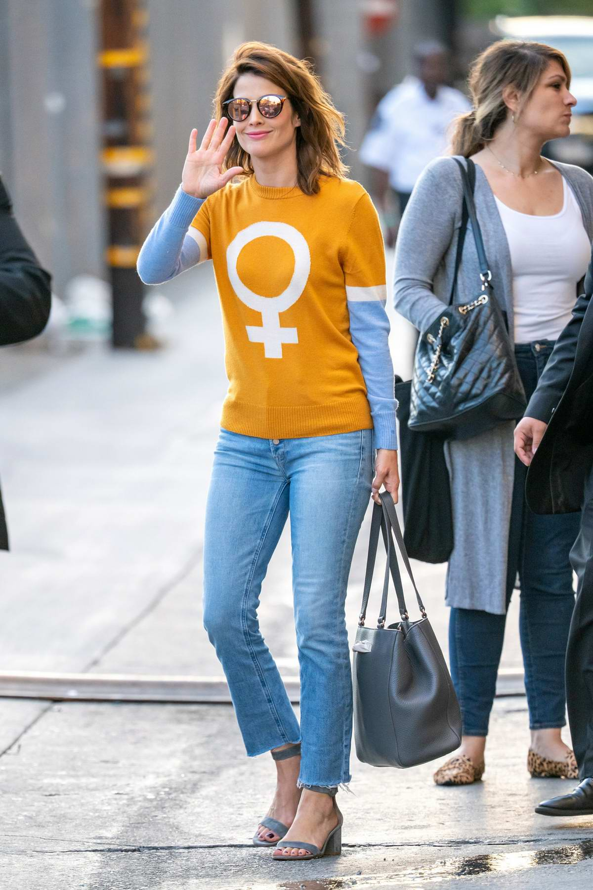 Cobie Smulders looks stunning in an orange full length shirt and jeans as she arrives at Jimmy Kimmel Live! in Los Angeles
