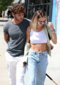 Delilah Hamlin and Eyal Booker pack on the PDA during lunch at Toast Cafe in West Hollywood, Los Angeles