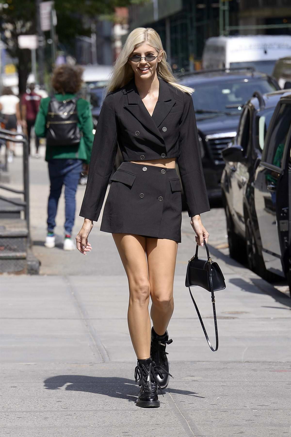 Devon Windsor looks stylish in a black double-breasted skirt suit while out in SoHo, New York City