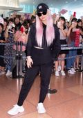 Dove Cameron greets fans as she touches down at Haneda International Airport in Tokyo, Japan