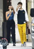 Dua Lipa and Anwar Hadid give photographer the finger after buying ice cream at Kith store in SoHo New York City