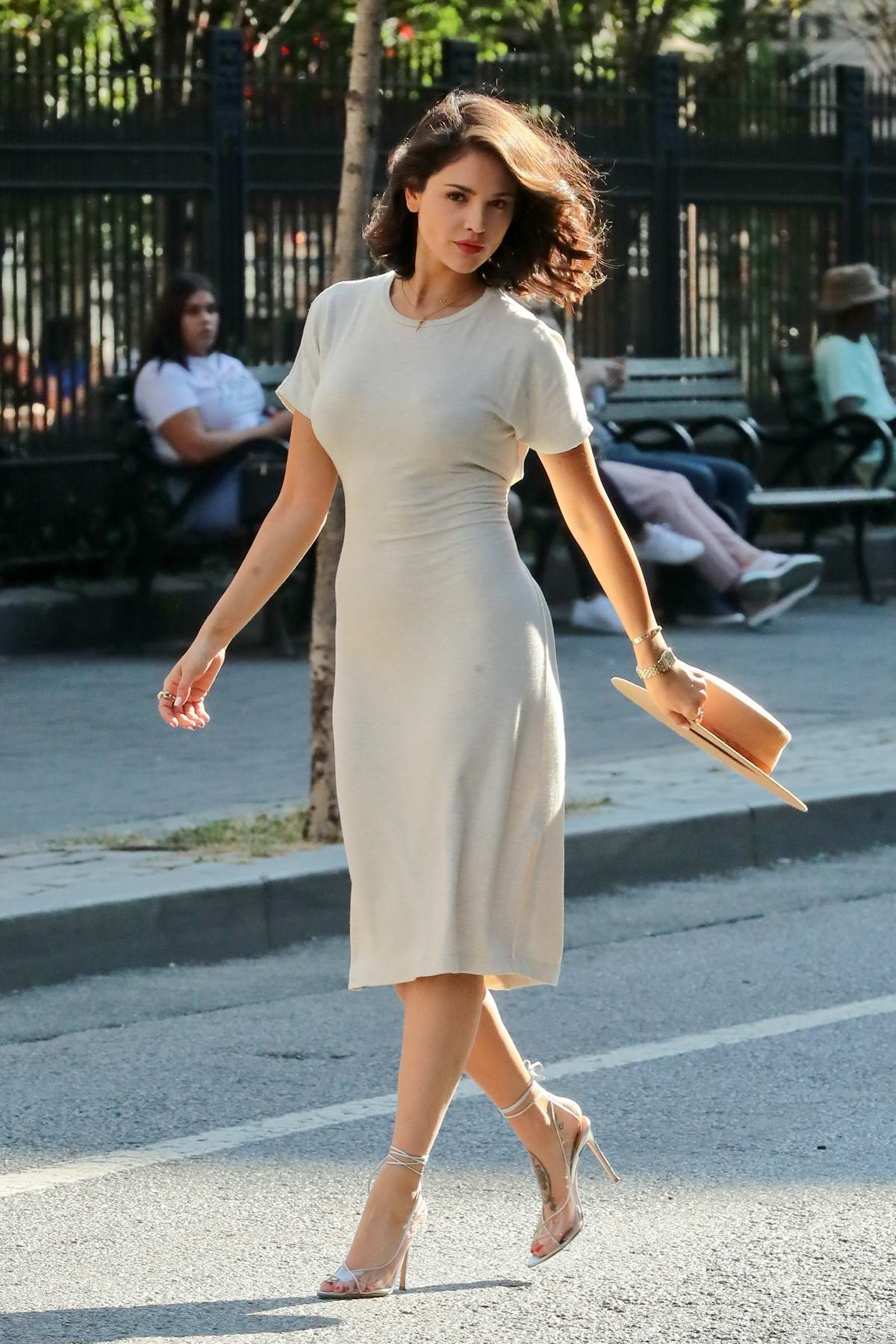 Eiza Gonzalez twirls a hat during a casual photoshoot on the streets of SoHo in New York City