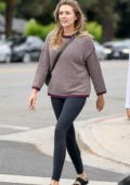 Elizabeth Olsen wears a striped sweater and black leggings as she heads to a yoga class in Los Angeles